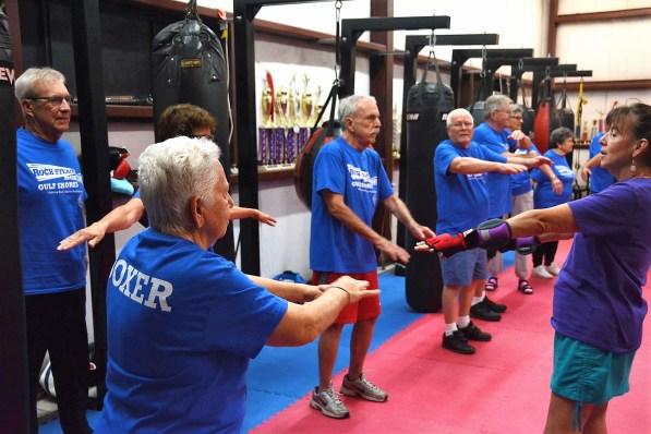 Participants exercise at Rock Steady Boxing in Gulf Shores. (Karim Shamsi-Basha / Alabama NewsCenter)