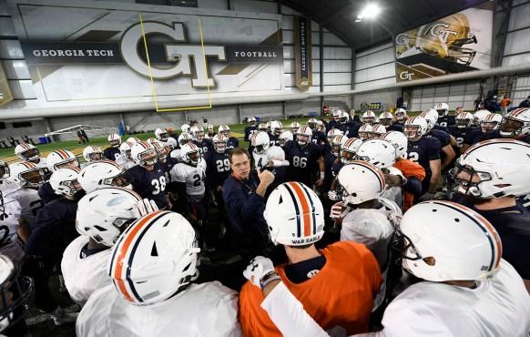 Auburn head coach Gus Malzahn talks to his team before practice on Thursday in Atlanta. (Todd Van Emst/AU Athletics)