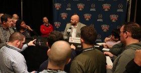 Alabama Offensive Coordinator and Quarterbacks Coach Brian Daboll talks with the press in New Orleans. (Kent Gidley / University of Alabama Athletics)