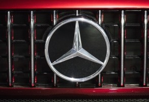 A badge sits on the front grille of a Mercedes-Benz AG AMG GT concept sports vehicle displayed at the Handelsblatt auto industry conference in Sindelfingen, Germany, in October. The company has a comfortable U.S. sales lead among luxury brands in 2017. (Alex Kraus / Bloomberg)