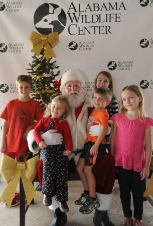 Santa Claus is having a great time with these young guests! (Contributed)