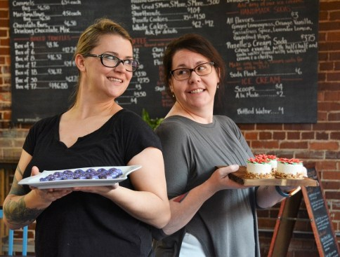 Sisters Michelle Novosel, left, and Caitlin Lyon hold some of their creations in the dessert café. (Karim Shamsi-Basha / Alabama NewsCenter)
