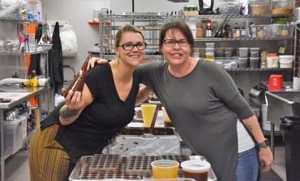 Sisters Michelle Novosel, left, and Caitlin Lyon work in the kitchen. (Karim Shamsi-Basha / Alabama NewsCenter)