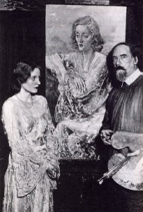 Photograph of Tallulah Bankhead, posing with artist Augustus John, in front of a portrait he had painted of her, 1929. (Wikipedia)