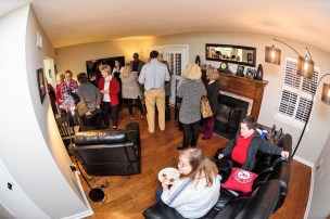 Friends, family and University of Alabama CrossingPoints faculty check out Cody Pope's new home. (University of Alabama)