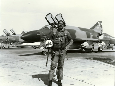 "Col. Daniel ""Chappie"" James stands in front of his McDonnell-Douglas F-4C Phantom fighter jet in the mid-1960s. During the Vietnam War, James was stationed in Thailand and flew nearly 80 missions over Vietnam. (From Encyclopedia of Alabama, United States Air Force)"