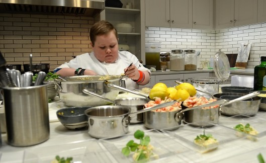 Fuller Goldsmith puts the finishing touches on spring vegetable and crawfish risotto. (Michael Tomberlin / Alabama NewsCenter)