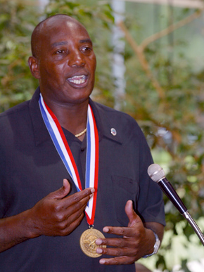 Muscle Shoals native Ozzie Newsome Jr. (1956- ) speaks to a crowd in Daphne, Baldwin County, after being honored with the Eagle Award by the U.S. Sports Academy in June 2003. Newsome was a University of Alabama Crimson Tide standout and went on to a celebrated National Football League career as a player and executive. (From Encyclopedia of Alabama, courtesy of The Mobile Press-Register)