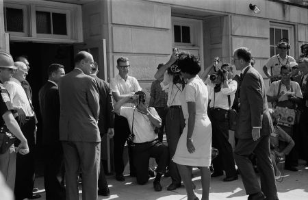 Vivian Malone entering Foster Auditorium to register for classes at the University of Alabama. Malone had to walk through a crowd that included photographers, National Guard members, and Deputy U.S. Attorney General Nicholas Katzenbach, June 11, 1963. (Photograph by Warren K. Leffler, U.S. News and World Report, Wikipedia)