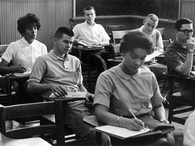 """Vivian Malone, far left, was one of the first African-American students to attend the University of Alabama and the first black graduate of the school. Malone was blocked from enrolling during Alabama Gov. George Wallace's famous """"stand in the schoolhouse door"""" to oppose integration of the university in 1963. (From Encyclopedia of Alabama, courtesy of W.S. Hoole Special Collections Library, The University of Alabama Libraries)"""