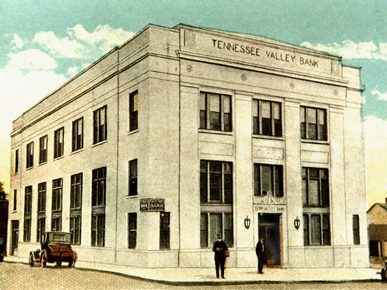 This vintage postcard depicts the current headquarters of the Morgan County Archives during its use as the Tennessee Valley Bank in about 1927. (From Encyclopedia of Alabama, Morgan County Archives)
