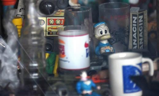 An eclectic collection of pop culture figures and memorabilia was always an attraction at Vincent Oliver's Hippodrome Barber Shop in Woodlawn. (Solomon Crenshaw Jr. / Alabama NewsCenter)