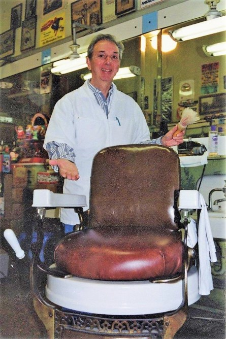 Vincen Oliver cut hair in the Woodlawn community from 1966 until his death earlier this month. (Dan Bynum / Alabama NewsCenter)