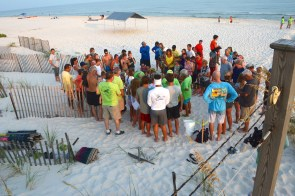 Share the Beach operations draw a crowd of curious beachgoers. (Karim Shamsi-Basha/Alabama NewsCenter)