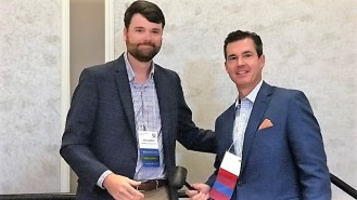 Lee Lawson, president and CEO of the Baldwin County Economic Development Alliance, left, passes the gavel as EDAA president to Patrick Murphy, vice president of Business, Sales and Economic Development at Alabama Power, during the 2018 EDAA summer conference. (Michael Tomberlin / Alabama NewsCenter)