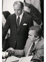 Alabama Gov. George Wallace, seated, and Birmingham Mayor Richard Arrington Jr. discuss in February 1984 a bill authorizing a horse track with legalized gambling in Birmingham. (From Encyclopedia of Alabama, courtesy of the Alabama Department of Archives and History, photograph by James Hatcher)