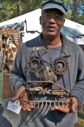 Outsider artist Charlie Lucas poses with one of his sculptures at the Kentuck Festival of Art in Northport, Tuscaloosa County, in October 2008. (From Encyclopedia of Alabama, photo copyright by Kelly Ludwig 2013, detour art.com, all rights reserved)