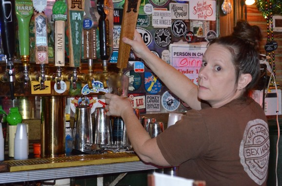 The beer flows at Haint Blue's opening bash in Mobile. (Michael Tomberlin/Alabama NewsCenter)