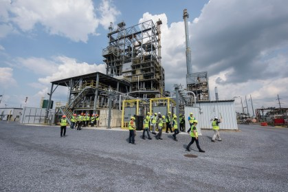 Global carbon capture experts visit the National Carbon Capture Center's post-combustion carbon capture facility at Alabama Power's Plant Gaston last year. The center is among Southern Research's partners in new grant-funded research on conversion of carbon dioxide into ethylene. (Wynter Byrd / Alabama NewsCenter)