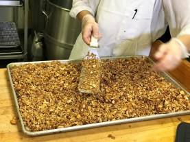 Patti Montalbano Sansom, baker at Iz, prepares a batch of Iz Good Stuff Granola. (Michael Tomberlin / Alabama NewsCenter)