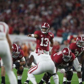 Alabama quarterback Tua Tagovailoa (13) surveys the line. (Kent Gidley)