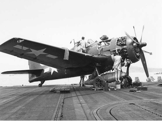 "A U.S. Navy Grumman F6F-5 Hellcat fighter undergoing maintenance on board the aircraft carrier USS Essex (CV-9), July 30, 1944. This plane is ""Minsi II,"" belonging to the Essex Air Group Commander, Commander David McCampbell, USN. (U.S. Navy, Wikipedia)"