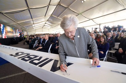 During a groundbreaking ceremony, Alabama Gov. Kay Ivey signs a beam for the new Airbus A220 assembly line in Mobile. (Alabama Governor's Office)