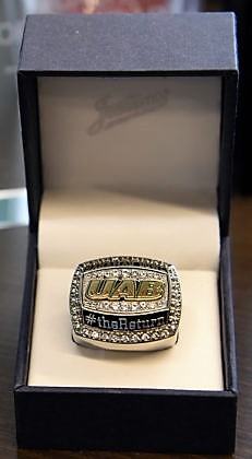 A 2017 UAB football ring is displayed. The 2018 Conference USA championship rings are being prepared now. (Mark Almond)