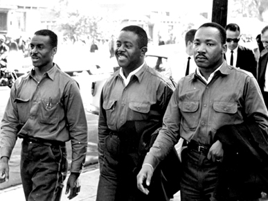 "Fred Lee Shuttlesworth (left), Ralph David Abernathy (center) and Martin Luther King Jr. (right) march on Good Friday on April 12, 1963, in Birmingham. The men were later arrested, prompting King to write his famous ""Letter from Birmingham Jail."" (From Encyclopedia of Alabama, courtesy of Birmingham Public Library Archives)"