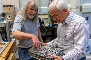 Lab technician Mike Crumpler, left, and materials engineering professor Tony Overfelt examine metal components in the lab. Overfelt is director of the Center for Industrialized Additive Manufacturing and principal investigator on a $1.5 million grant from the National Institute of Standards and Technology to research ways for smaller manufacturers to incorporate additive technology into their processes. (Auburn)