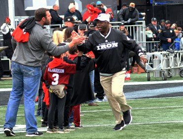 Head Coach Tim Lewis slaps hands with a fan. (Solomon Crenshaw Jr./Alabama NewsCenter)