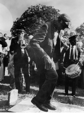The Excelsior Band performs during the Mardi Gras celebration known as Joe Cain Day, during which revelers dance on the grave of Joseph Stillwell Cain, the man who revived Mobile's Mardi Gras tradition after the Civil War. (From Encyclopedia of Alabama, The Doy Leale McCall Rare Book and Manuscript Library)