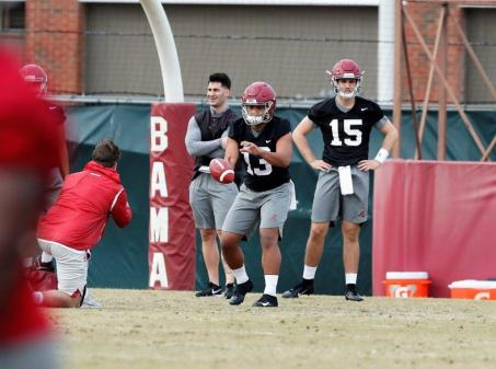 Tua Tagovailoa (13) takes a snap while Paul Tyson (15) looks on during Alabama's spring practice Friday. (Noah Sutton/UA Athletics)