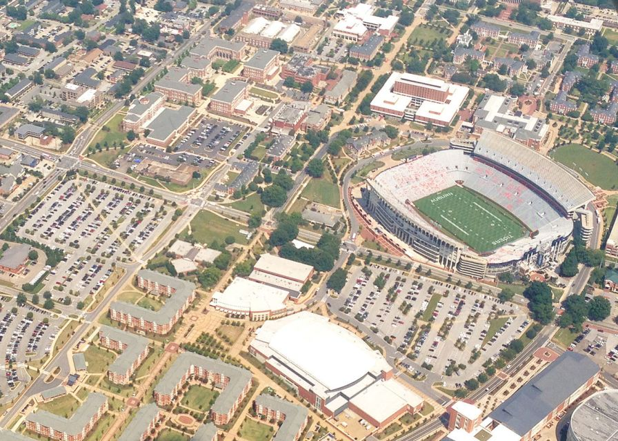 Aerial view of Jordan Hare Stadium, Auburn Arena, The Village, Samuel Ginn Engineering Complex, and the Haley Center, 2013. (Vestaviahills, Wikipedia)