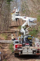 Alabama Power crews worked to restore power to those who affected by the storms and tornadoes that swept through the state March 14. (Dennis Washington / Alabama NewsCenter)