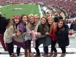 Hannah Brown, third from left, at a University of Alabama football game. She graduated in 2017. (file)