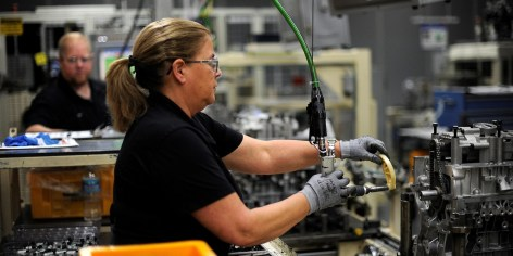A Hyundai employee works on the engine line in Montgomery. The company recently completed a $388 million expansion of the factory. (contributed)