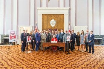 Alabama Gov. Kay Ivey was joined by legislators and members of the Alabama Rural Broadband Coalition for the signing of two bills that will expand broadband in the state. (Sydney A. Foster/Governor's Office)