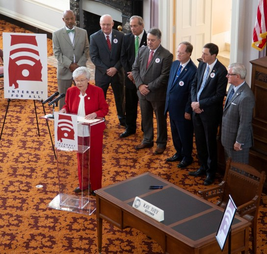 Alabama Gov. Kay Ivey was joined by legislators and members of the Alabama Rural Broadband Coalition for the signing of two bills that will expand broadband in the state. (Governor's Office/Hal Yeager)
