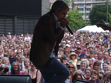 """Birmingham native and """"American Idol"""" winner Taylor Hicks performs in June 2006 at City Stages, an annual Birmingham concert festival that ran from 1989 to 2009. (From Encyclopedia of Alabama, courtesy of The Birmingham News, photograph by Linda Stelter)"""