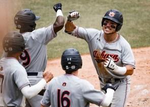 Judd Ward (1) celebrates with teammates. (Cat Wofford/Auburn Athletics)