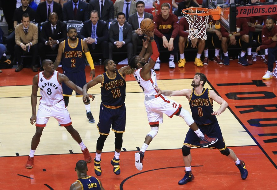 DeMarre Carroll of the Toronto Raptors shoots the ball against Tristan Thompson and Kevin Love of the Cleveland Cavaliers during the second half in game three of the Eastern Conference Finals during the 2016 NBA Playoffs at Air Canada Centre on May 21, 2016 in Toronto. (Photo by Vaughn Ridley/Getty Images)