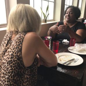 Chef Kimberly McNair Brock, talking to a fellow community business owner, joins Urban Ministry to help prepare fresh foods. (Keisa Sharpe)