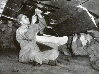 Engineers perform maintenance on an airplane at Craig Field near Selma, ca. 1942. The field was built during the lead-up to World War II to train cadets to fly single-engine aircraft and named to honor Bruce Kilpatrick Craig, a Selma native and officer of the Infantry Reserve who was killed in a plane crash in 1941. (From Encyclopedia of Alabama, Air Force Historical Research Agency)