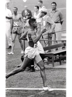 Former University of Oregon athlete Otis Davis finishes first in the second semifinal of the men's 4x400 meter relay at the 1960 Olympics in Rome, Italy. The U.S. team went on to win the gold medal in the event. (From Encyclopedia of Alabama, courtesy of University of Oregon Libraries)