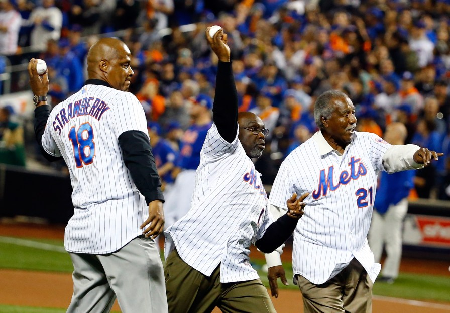 New York Mets former players Darryl Strawberry, Mookie Wilson and Cleon Jones throw out the ceremonial first pitch prior to Game Five of the 2015 World Series between the Kansas City Royals and the New York Mets at Citi Field on Nov. 1, 2015. (Photo by Al Bello/Getty Images)