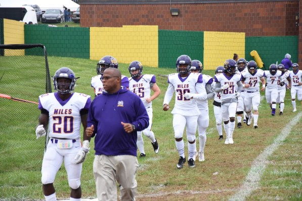 Reginald Ruffin leads his team onto the field. (Miles College Athletics)