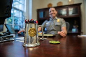 Auburn graduate Lisa Hendy, chief ranger of the Great Smoky Mountains National Park, keeps her alma mater keepsake close by. (Philip Smith)