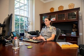 Auburn graduate Lisa Hendy, chief ranger of the Great Smoky Mountains National Park, works in her office near Gatlinburg. (Philip Smith)