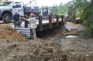 Workers install a bridge over St. Clair County's Little Canoe Creek. (Karim Shamsi-Basha/Alabama NewsCenter)